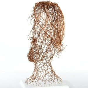 side on view of copper wire head, emphasis is on highlighting hair, beard and mustache, head is flexible and touch friendly