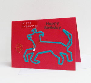 landscape style happy birthday fluffy green dog playing with leather ball greetings card